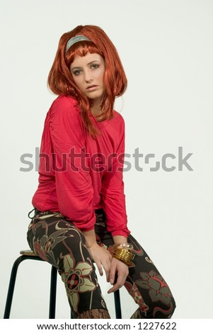 Retro Redhead - Beautiful model with retro make up, hairdo and outfit.