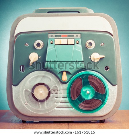 Retro reel to reel tape recorder front mint green background - stock photo