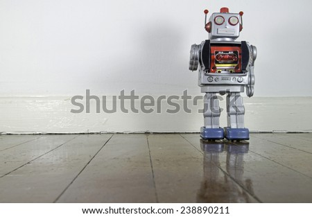 retro robot on old wooden floor - stock photo