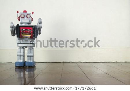retro robot on wooden floor  - stock photo