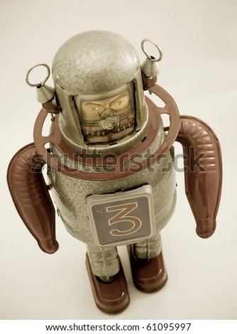 retro robot toy in retro color - stock photo