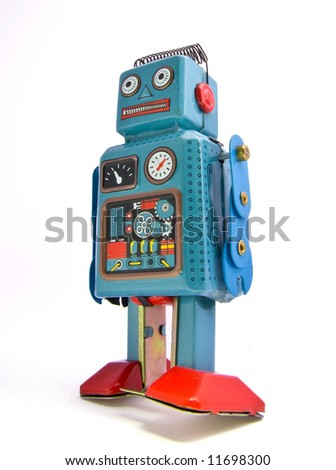 retro robot toy on white - stock photo