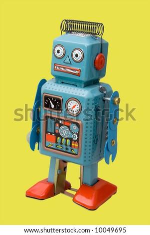 retro robot toy yellow background - stock photo