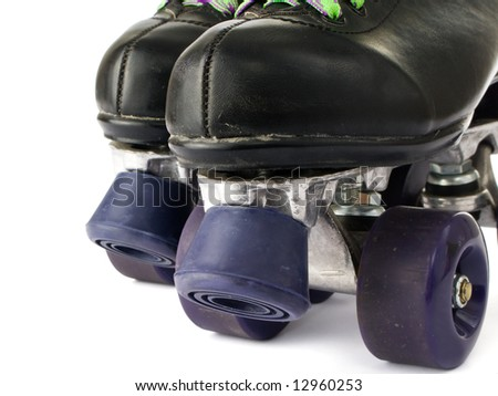Retro roller skates isolated on white background - stock photo