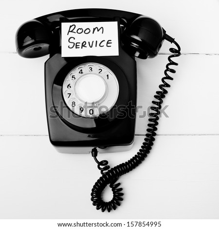 Retro room service telephone - stock photo