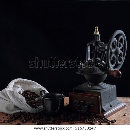 Retro rustic coffee grinder with bag of coffee beans