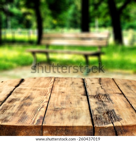 retro rustic table and bench background in park of spring  - stock photo
