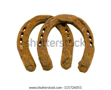 Retro rusty pair of horseshoes isolated on white background. - stock photo