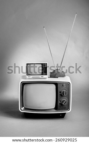 Retro 60's TVs in black and white. - stock photo