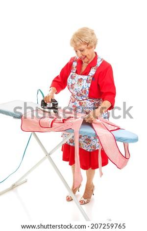 Retro senior grandmother does the ironing.  Full body isolated on white.   - stock photo