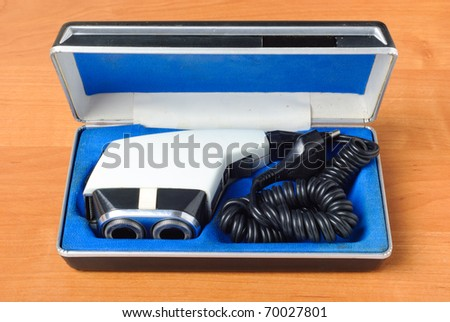 Retro shaver machine  in the box a on wood surface - stock photo