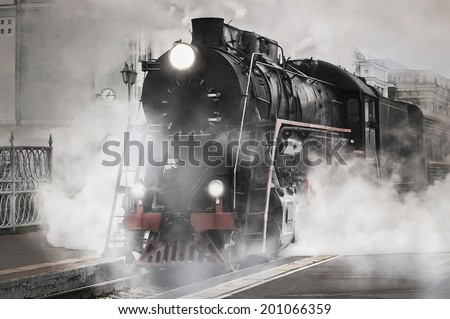 Retro steam train departs from the railway station. - stock photo