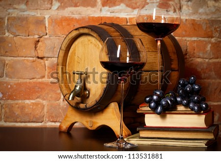 Retro still life with red wine, books and barrel