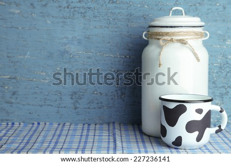 Retro still life with tasty rustic milk, on table - stock photo