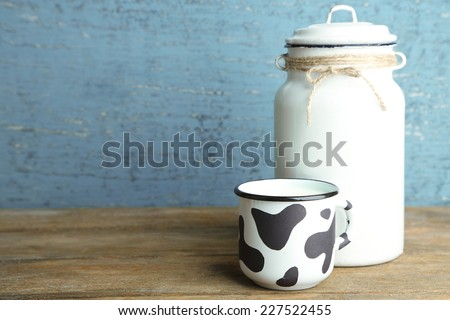 Retro still life with tasty rustic milk, on wooden table - stock photo