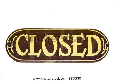 retro storesign closed - on a wooden board - stock photo