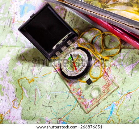 retro style abstract shoot with the compass on a map  - stock photo
