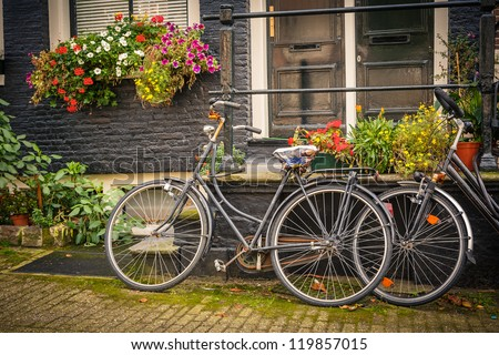 Retro style bicycles in Amsterdam, Netherlands - stock photo