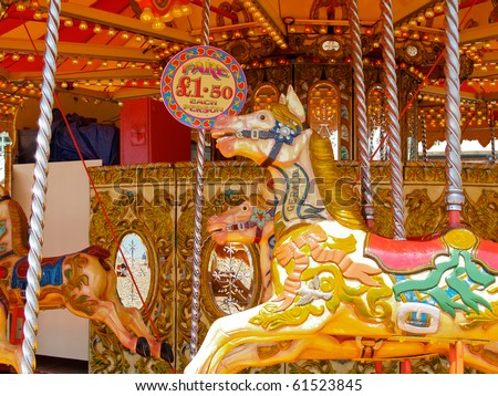 Retro style carousel horse on a traditional fairground carousel.