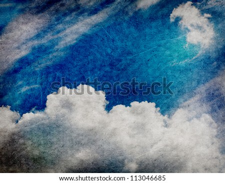 Retro style cloudscape with vintage colors and a textured paper background. - stock photo