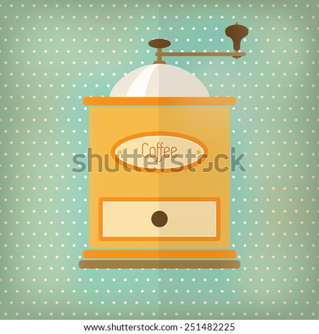 Retro style coffee grinder, with drawer and label, over faded turquoise polka dot background.  - stock photo