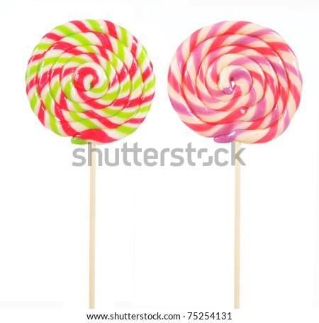 retro style colorful round shape lollipop on white background - stock photo