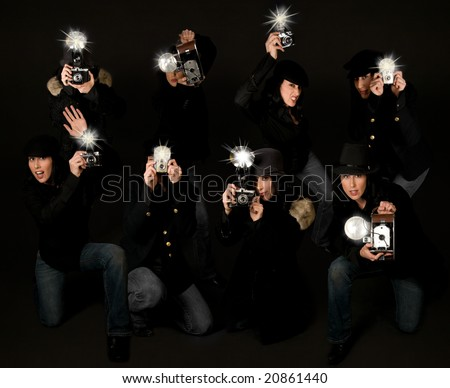 Retro style female paparazzi press photographers with vintage cameras - stock photo