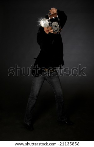 Retro style female photographer with vintage camera and flash - stock photo