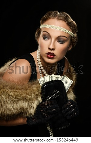 Retro style gangster girl with dollars on black background - stock photo