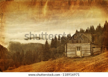 Retro style image of abandoned wooden house at mountain hill - stock photo