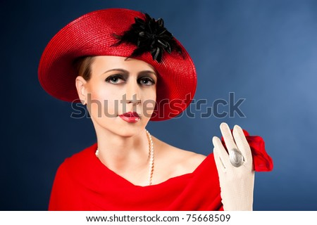 Retro style imitating fashion portrait of a young woman in red hat. Clothing and make-up in vintage style - stock photo