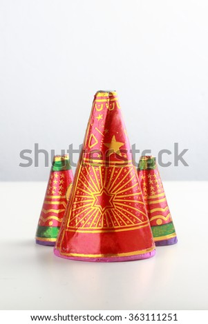 Retro style Indian firecrackers on white background - stock photo