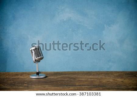 Retro style microphone - stock photo