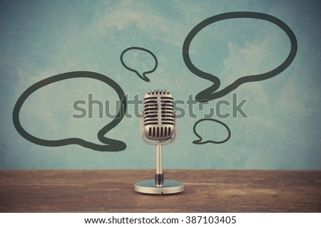 Retro style microphone with blank balloons text box - stock photo
