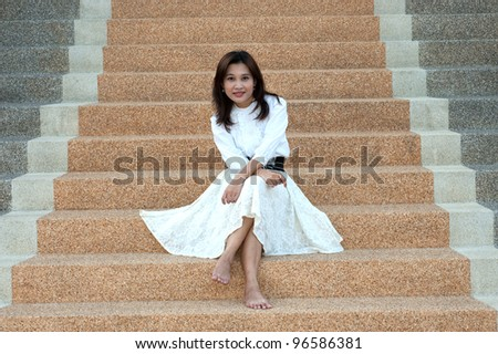 Retro style of pretty asian woman on stairs .