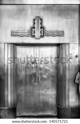 Retro style outdoor elevator door in Fort Worth, TX - stock photo