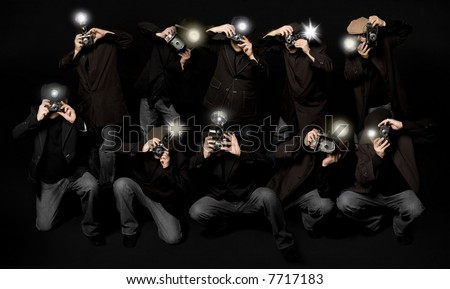 Retro style paparazzi press photographers with vintage cameras - stock photo