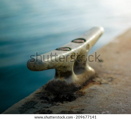 Retro Style Photo Of A Nautical Harbor Yacht Cleat In Hawaii - stock photo