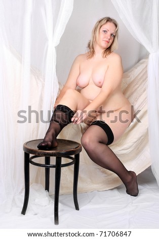 Retro style picture of a overweight woman in vintage bedroom. - stock photo