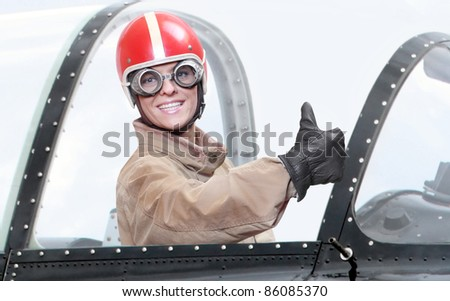 Retro style picture of a pilot in cockpit of a vintage plane. Close up with shallow DOF. - stock photo