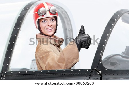 Retro style picture of a pilot in cockpit of a vintage plane. Close up with shallow DOF.