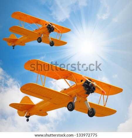 Retro style picture of the old biplanes. - stock photo