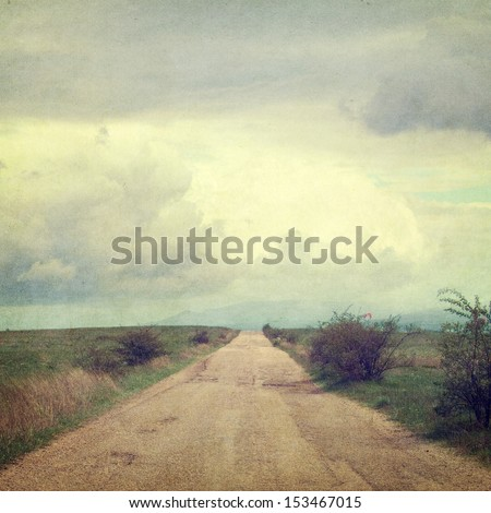 retro style picture with road and clouds - stock photo