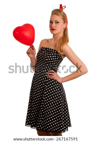 Retro style pin up girl with blonde hair in black dress with white dots isolated over white background - stock photo