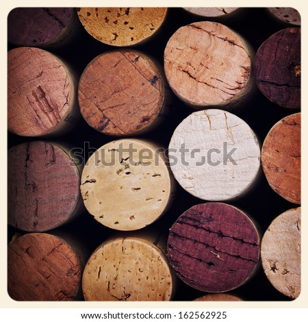 Retro style pink wine cork background. Cross processed to look like an aged instant photo. - stock photo