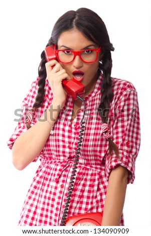 Retro style pinup girl receiving some shocking news over the phone - stock photo