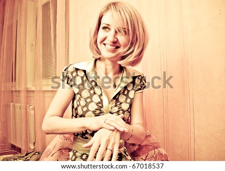 Retro style Portrait of a fresh and lovely woman making evening skin cleaning mask - stock photo