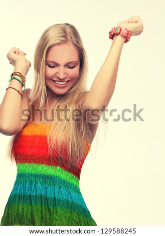 Retro style.Portrait of happy young adult woman dancing with her hands behind head. - stock photo