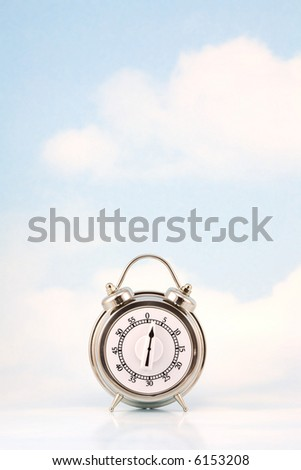 Retro style timer against sky background with clouds - stock photo