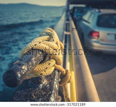 Retro Style Transportation Image Of A Car On A Ferry - stock photo